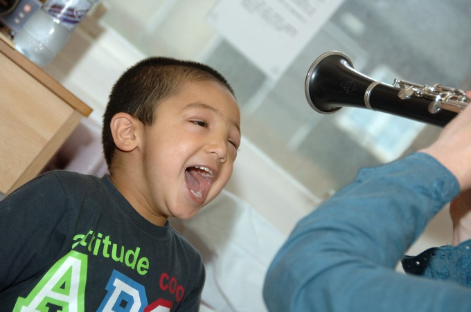 Child with clarinet at the Royal Manchester Children's Hospital